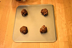 Place ball of dough on greased cookie sheet