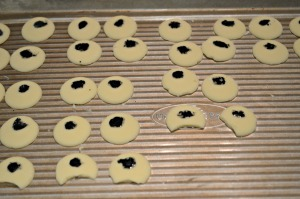 Apply the white chocolate buttons for eyes