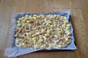 Sprinkle Oreo pieces and marshmallows on almond bark