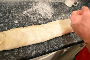 Slowly roll the dough into a circular roll
