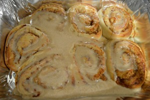 Pour the icing onto the cinnamon rolls